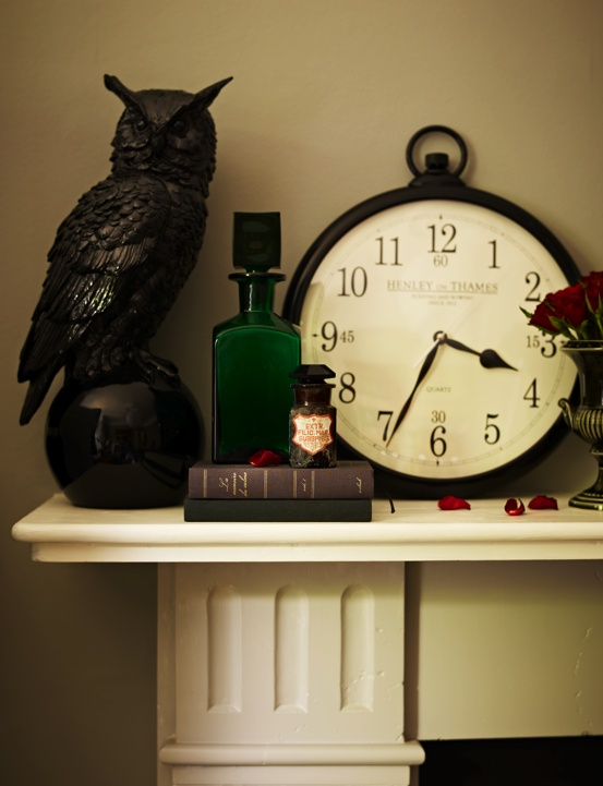 A vintage decanter, books, bottle and urn from Pitfield London in Kitchens Bedrooms and Bathrooms Magazine's Gothic Shoot
