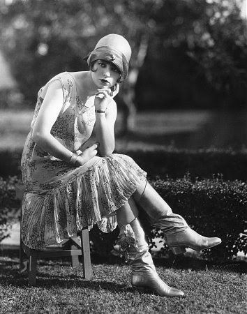 The name flapper refers to the fashion trend in the 1920's of women who wore their galoshes unfastened. The noise made when they walked sounded like their boots were flapping. This trend is resurfacing today with young women wearing their boots unfastened as a fashion statement.