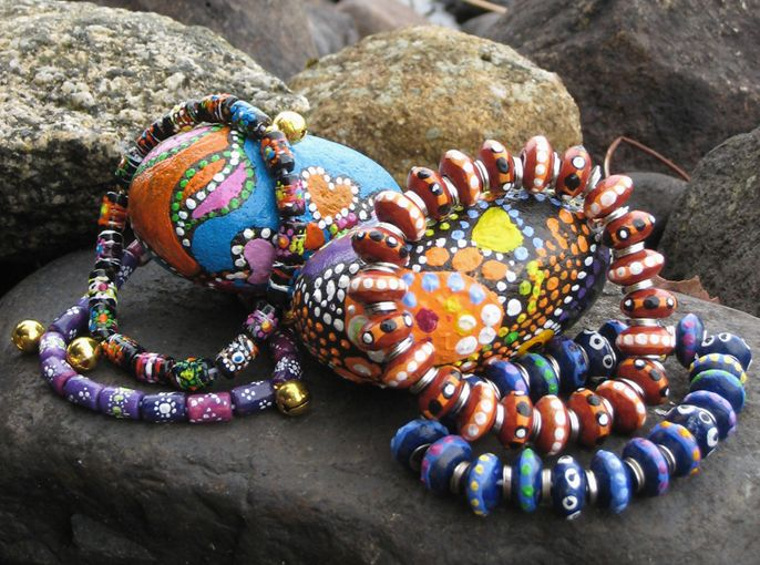 Acrylic paint on natural stones and wooden beads, by Sirkku 2009