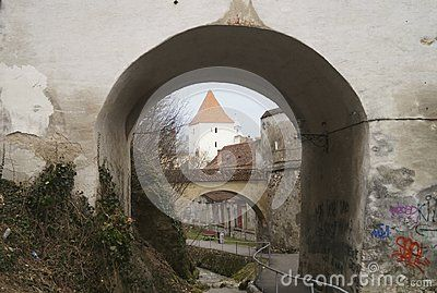 A defense tower seen through one of the arched gates of the Graft Bastion, Romania, Transylvania, Brasov Bastionul Graft 1515- 1521