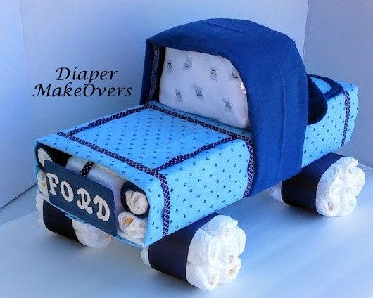 This Truck Diaper Cake is perfect for any baby shower. It makes a great Baby shower centerpiece or gift that will surely help you stand out above the crowd at the gift table. Each creations is loaded with essential baby items every parent will need for their new baby. Personalize the tailgate. You Can request to have the babys name put on in place of the Ford lettering. Just message me if you would like this option. If not stated, Ford will be used.  Includes: 70 size one diapers, 3…