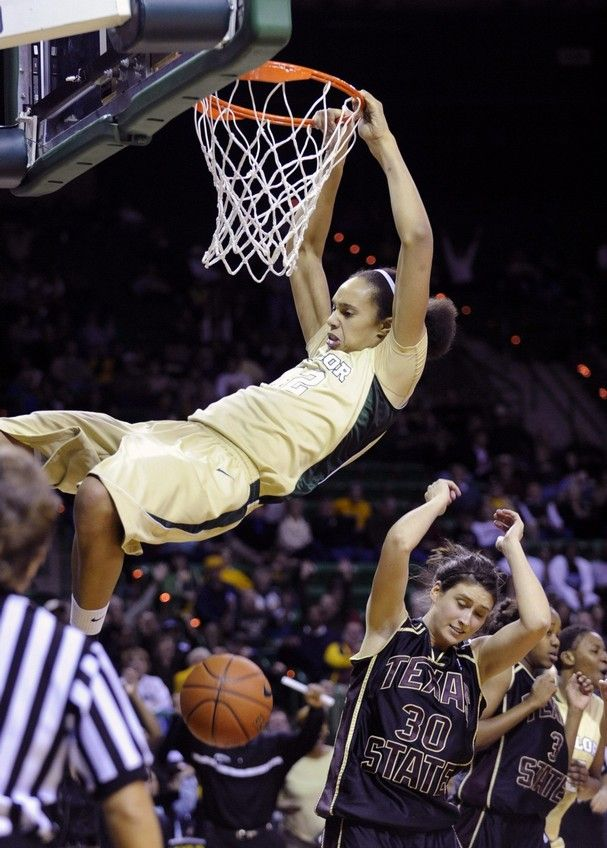 "Brittney Griner, 6' 8"" star college basketball player for Baylor, dunking."