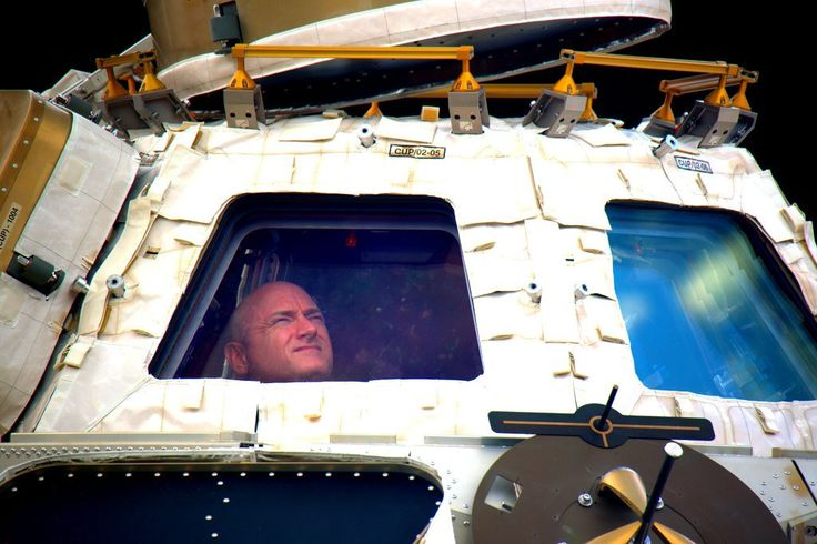 Astronaut Scott Kelly peers out of the ISS cupola. Last night he returned to Earth after 340 days in space. [1024x683]