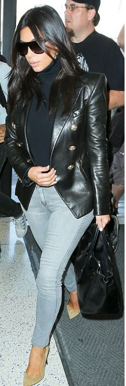 Kim Kardashian: Jacket – Balmain  Purse – Hermes  Jeans – BLEULAB  Shoes – Saint Laurent