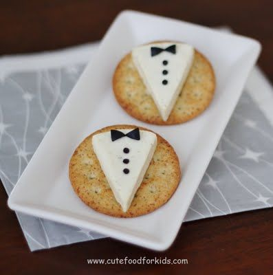 Perfect for wedding appetizer. Crackers with babybel cheese, and an olive cut up (you use a juice box straw to punch out the buttons!) So clever.