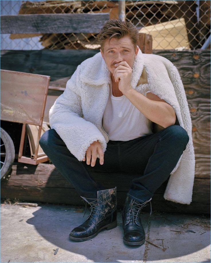 Starring in a photo shoot, Garrett Hedlund wears a Michael Kors jacket and jeans with a Buck Mason t-shirt. He also rocks Bed Stü boots.