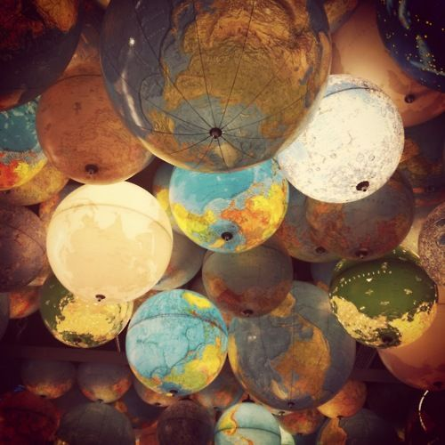 An around the world party with glowing globe lanterns.