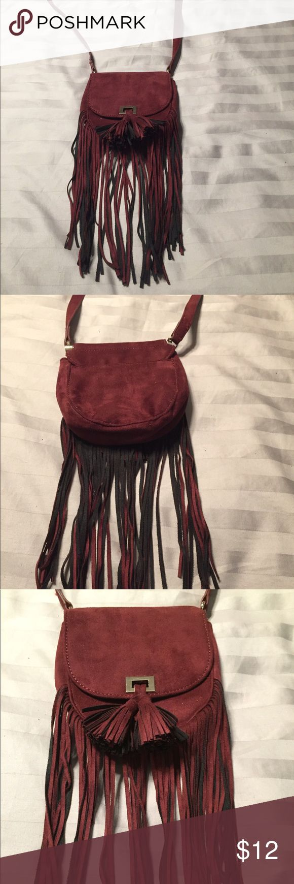 Burgundy suede purse with fringes In excellent condition,  only used once.  Got it at Express Store.  It's burgundy and suede material. Bags Shoulder Bags