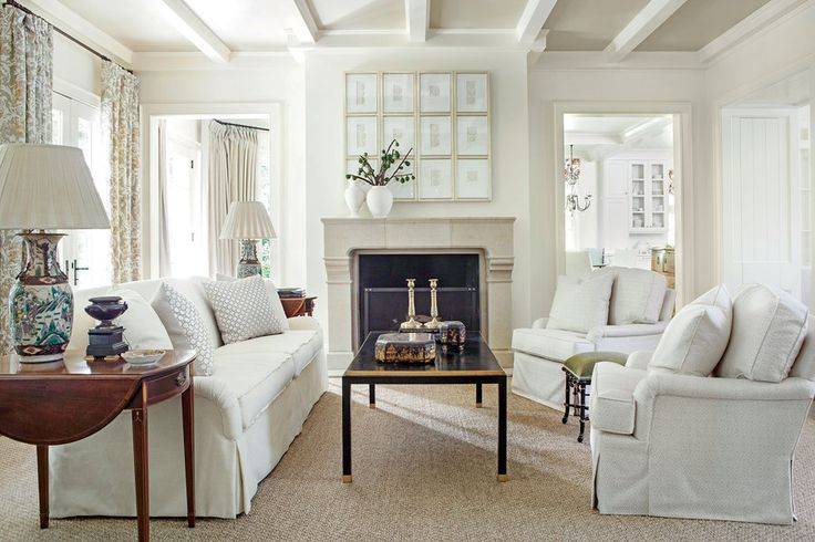 Achieve a luxe neutral look with white upholstery and decorative accents in a variety of light hues to add extra depth and dimension.  Similar throw pillows here.See more of this White Living Room