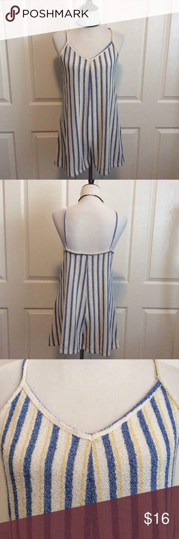 Beachy Striped Romper Blue, white and yellow striped romper. Understated metallic thread detail. NWT. 48%Poly, 39%Cotton, 11%Acrylic. Perfect throw on over a swimsuit. Or pair with sandals for the perfect sunny day out and about. Zara Shorts