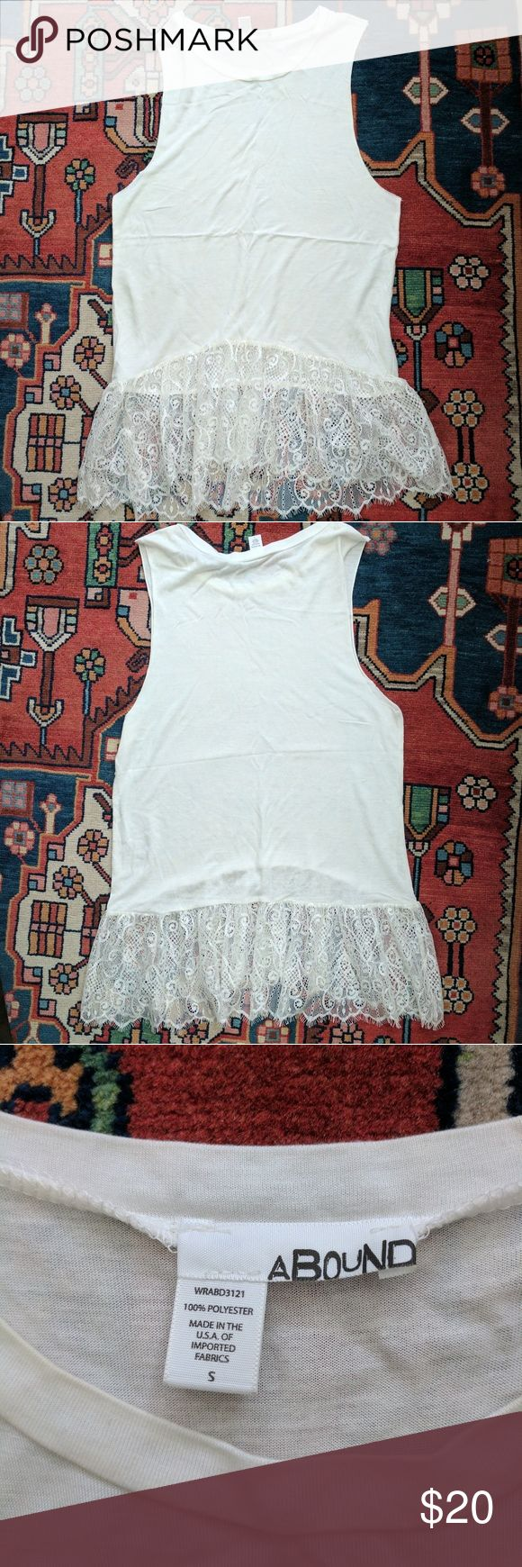 White lace tank top This Nordstrom top has cutoff style sleeves making it an edgy muscle tee but also has the lace bottom making it more feminine. So cute hardly worn no stains! Abound Tops