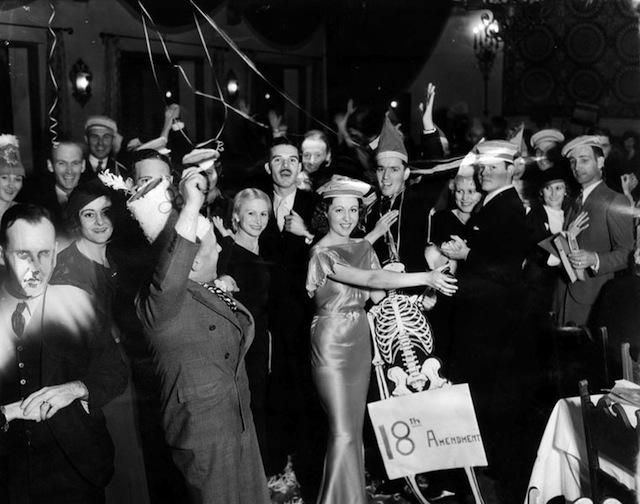 Party scene at Club Airport Gardens in Glendale to celebrate repeal of prohibition, Nov. 8, 1933. Decorations include a skeleton of the 18th...
