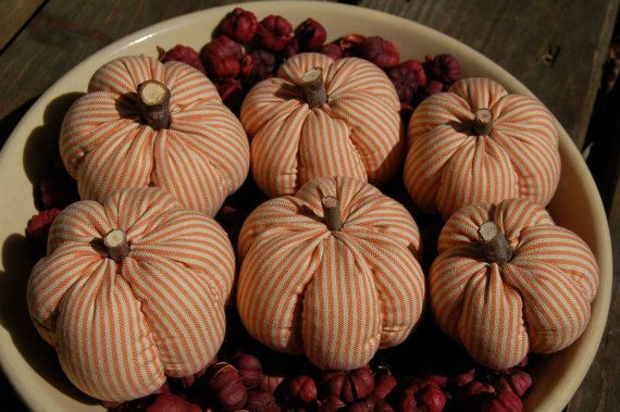 This is a set of primitive Fall striped pumpkin bowl fillers. These were handmade by me, using my own pattern. There are 6 ornies in the set. Each one is hand stitched stitched from a cream and orange striped fabric and each one has a real stick stem. Each pumpkin measures between 2 and 3 in diameter