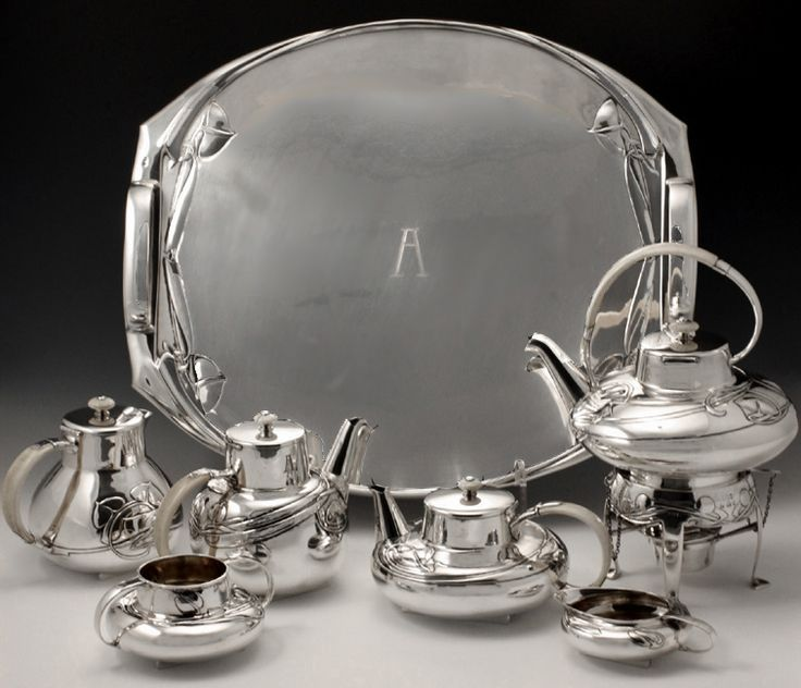 Archibald Knox for Liberty & Co, Arts & Crafts, Cymric, silver & ivory seven piece tea/coffee service.  Offered by Van Den Bosch at Grays.