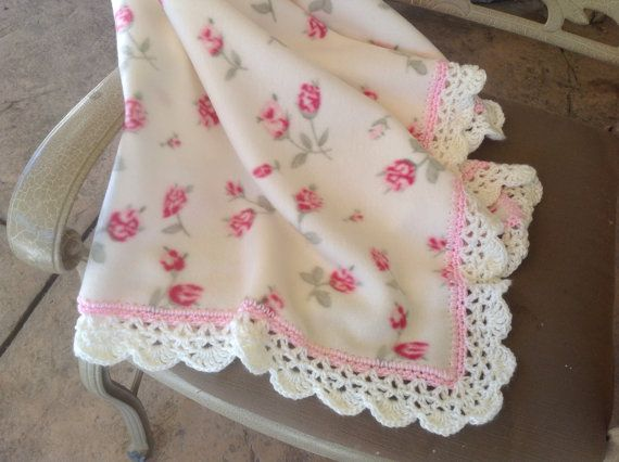Cute cream fleece blanket with pink roses. Blanket has a pretty pink and cream crocheted edging.  Blanket measures 40x 35 and is machine washable
