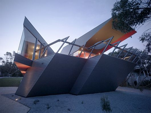 """The K House by ARM Architecture, """"The shape of the house and some items inside the home took the shape of the letter """"K"""". The facade is made with simple materials gray interiors look brighter, thanks to the large amount of painted surfaces with a cherry-red color."""""""