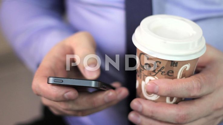 close-up man's hands using mobile phone touchscreen and cofee - Stock Footage…
