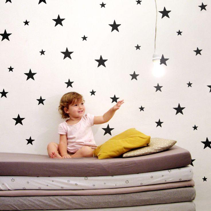 These sharp, black matte star wall stickers will add something to wish upon in any space! #blackandwhite #pishposhbaby