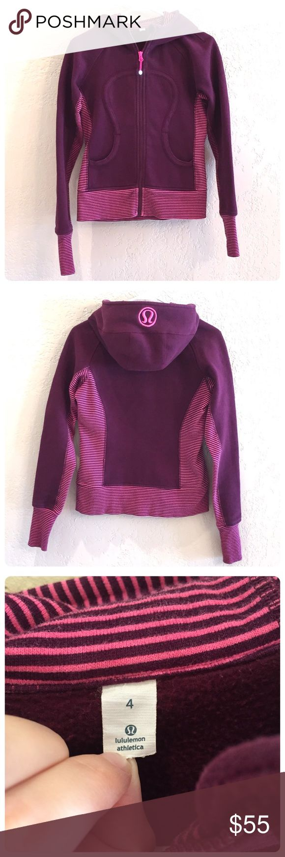 Lululemon Scuba Hoodie Lululemon Scuba Hoodie with thumb loops. Raspberry with pink and purple striped side panels. Thick and cozy, women's size 4. Slight fading from washing, gently used condition. lululemon athletica Tops Sweatshirts & Hoodies