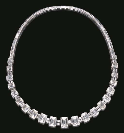 AN ELEGANT DIAMOND NECKLACE, BY VAN CLEEF & ARPELS The front set with a series of twenty-one graduated rectangular-cut diamonds, weighing from approximately 1.88 to 3.85 carats, each spaced by twin baguette-cut diamond links, to the graduated baguette-cut diamond backchain, mounted in platinum, (may be worn as two bracelets), necklace 14½ ins., bracelets 7 and 7½ ins., in a Van Cleef & Arpels gray suede case Signed VCA for Van Cleef & Arpels, NY, no. 20819