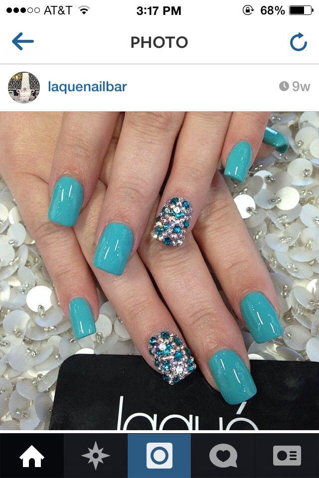 Blue rhinestone nail art