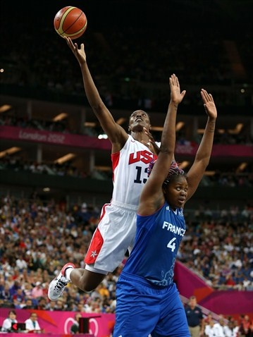 Photos - 2012 Olympics | London 2012  Olympics Day 15 - Basketball  Sylvia Fowles #13 of United States attempts a shot in the first half against Isabelle Yacoubou #4 of France during the women's Basketball Gold Medal game on Day 15 at North Greenwich Arena.