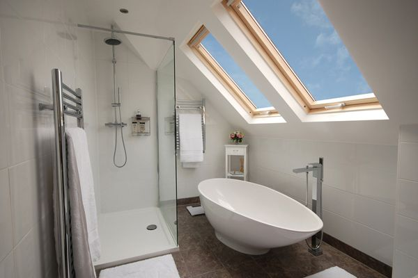Tuck slipper bath into eaves, tall hubby won't use it anyway, so shower needs max head height for him.