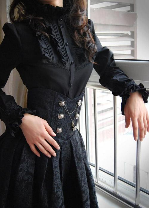 High-waisted corset skirt with brass button detail and GORGEOUS fabric.