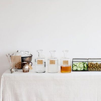rustic martini bar for springtime guests with crisp white linens, antique glassware and charmingly tarnished sterling silver bowls of ice . . .