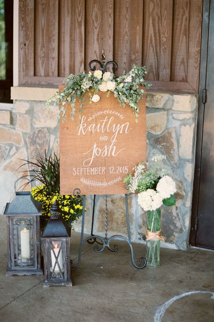 We are loving this sign and decorations! Check out more of this Rustic Elegant Oklahoma Wedding at The Springs in Tulsa on the Blog! | Kaitlyn + Josh | Brides of Oklahoma | Photography: Emily Ann Hughes #bridesofok #wedding
