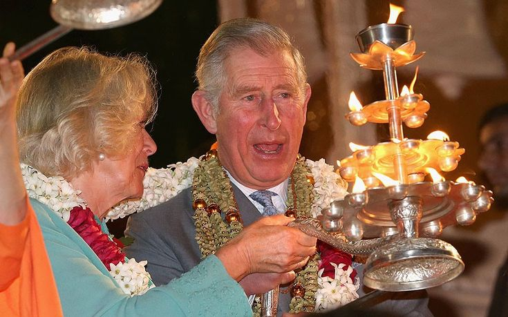 Camilla, Duchess of Cornwall and Prince Charles, Prince of Wales light candles during an Aarti ceremony at the Parmarth Niketan Temple on the banks of the River Ganges during day 1 of an official visit to India in Dehradun, India. #Royalty