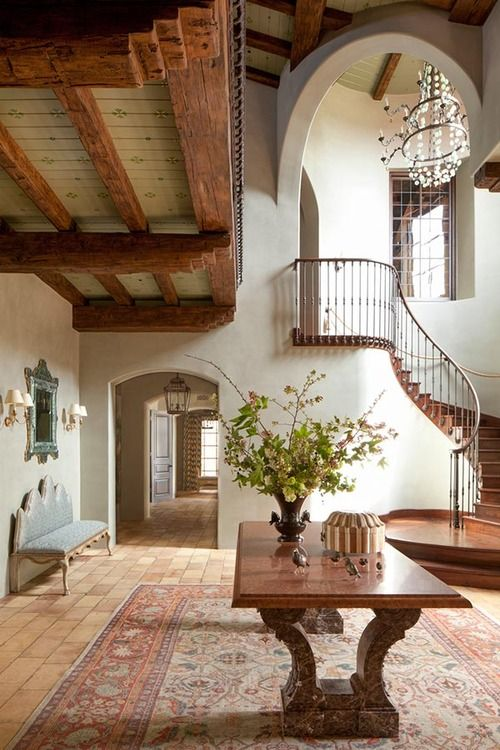 Spanish Colonial stairs and beams under balcony.  This space feels great.