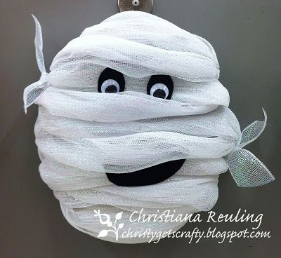 Halloween Mummy - it's just white deco mesh wrapped around a Styrofoam wreath and some black felt and googlie eyes