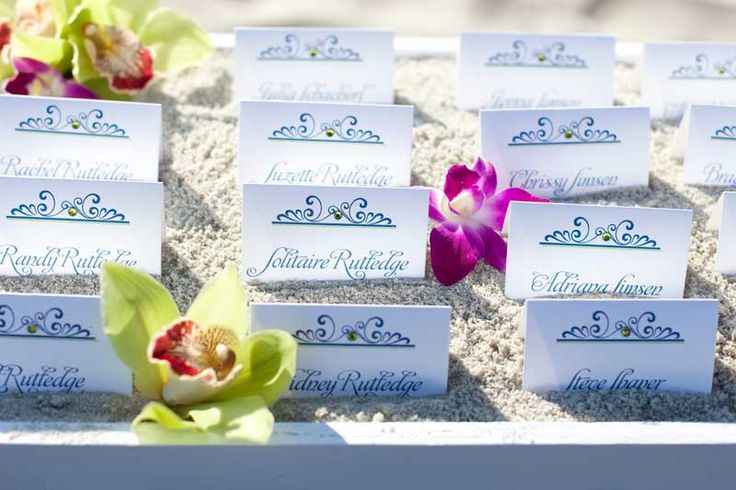name place cards? LOVE them in the sand...LOVE the gems....LOVE the orchids scattered