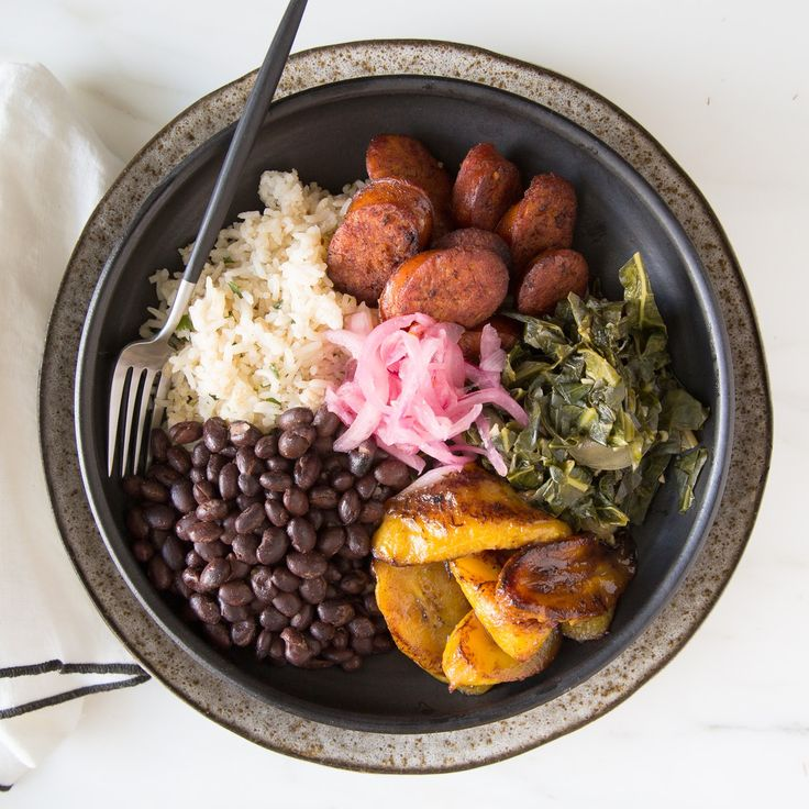 Brazilian Bowl. We created a lighter version of Brazil's classic stew feijoada. Coconut and orange scented steamed rice serves as a bed for sautéed collard greens, roasted plantains, black beans, and linguiça sausage. The dish is garnished with cilantro and spicy pickled red onion. A flavorful pork broth is provided on the side for easy reheating. Bom proveito!