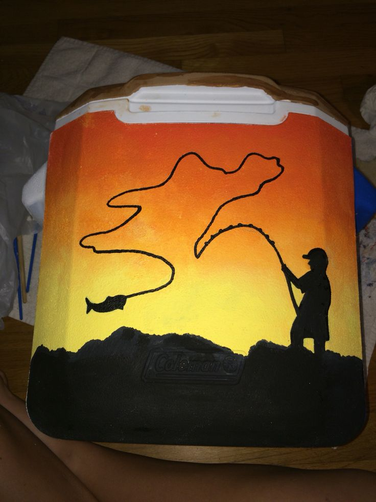 Cooler painting - silhouette of a man fishing in the sunset