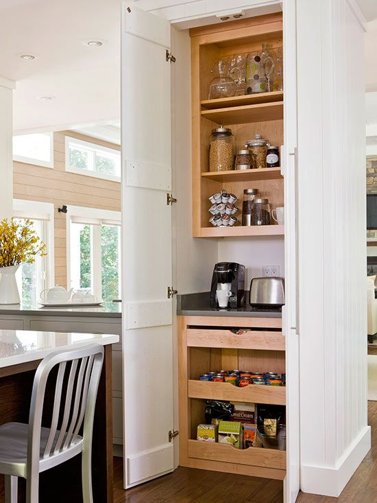 Turn a small stretch of wall into a hardworking breakfast station. Use cabinet doors to help it blend into the kitchen. Use open shelves to keep creamers, coffee beans, cereals, mugs, and juice pitchers within reach. A small countertop near electrical outlets is the perfect spot to house a coffeepot and toaster. Heavy-duty pullout drawers at the bottom can hold muffin mixes, cereal boxes, and heavy canned goods./