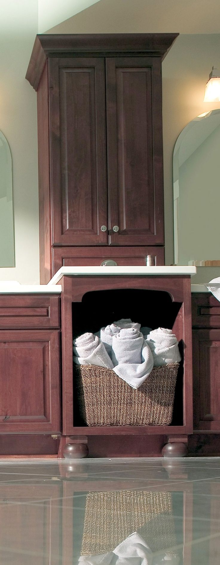 Include laundry basket storage in your bathroom vanity design to accommodate freshly clean towels or your dirty linens and garments. – Find more ideas like this on DuraSupreme.com  #bathroom #cabinetry #cabinets #vanity