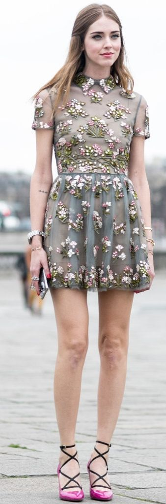 Chiara Ferragni wearing an embroidred floral minidress with lace up pink pumps