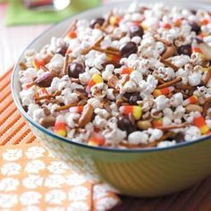 According to the neighborhood kids, there's nothing better than buttered popcorn with M&Ms and candy corn.  This recipe also incorporates pretzel sticks, peanut butter chips and chocolate chips.