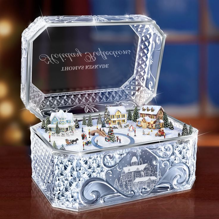The Thomas Kinkade Crystal Music Box - Hammacher Schlemmer - This is the molded crystal music box inspired by the original artwork of renowned holiday artist Thomas Kinkade.