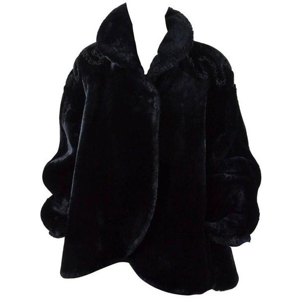Preowned Vintage Fendi Black Shearling Curly Fur Trim Open Front Long... ($1,095) ❤ liked on Polyvore featuring outerwear, coats, black, leather-sleeve coats, vintage swing coat, long sleeve coat, vintage shearling coat and fendi coat