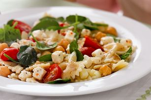 Greek Isles Pasta Salad recipe - Can't make it to the Greek isles this year? Take a shorter trip to the supermarket to get feta and vegetables for this tasty pasta salad.