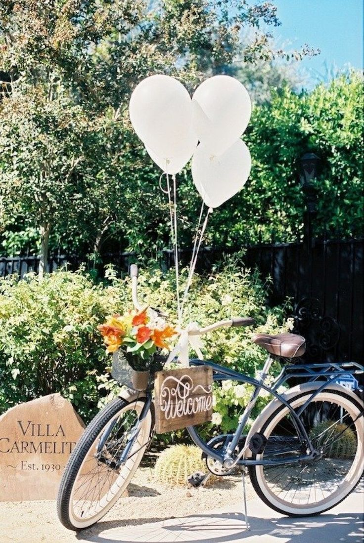 #balloons #bicycles Photography by bwrightphoto.com Event Coordination by annjkim.com Floral Design by mylittleflowershop.com  Read more - http://www.stylemepretty.com/2013/06/05/palm-springs-wedding-from-bwright-photography/
