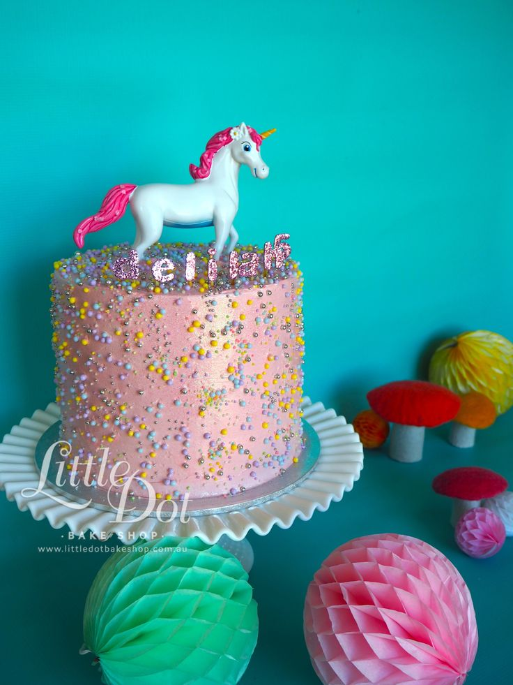 Pastel Multilayer Cake with a magical Unicorn...