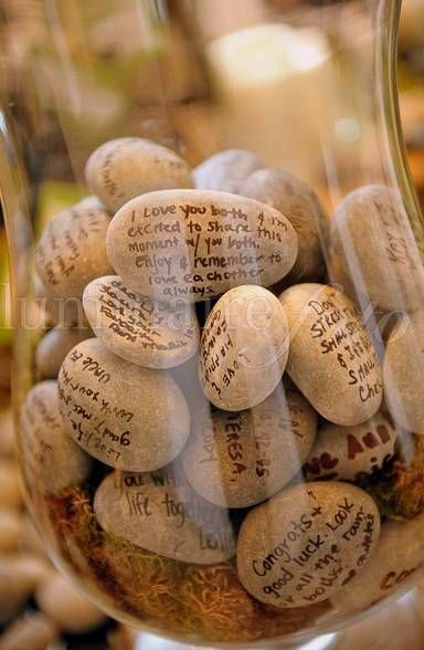Allow you guests to write messages on stones, which can later be displayed in a lovely vase. To prevent the well-wishes and messages from fading, you should spray the stones with clear acrylic gloss.
