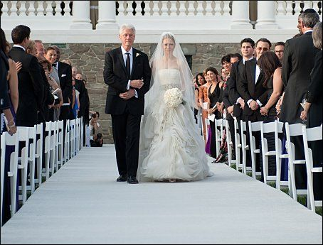 Stunning President Bill Clinton walks Chelsea Clinton down the aisle during her wedding to Marc Mezvinsky at the Astor Courts Estate on July in Rhinebeck