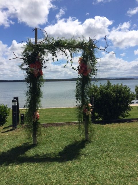 Sarah's #gorgeous #outdoor #wedding #ceremony @Raffertysresort #rusticarch #white #folding #chairs #blackboard #rosepetals #PeterHerdFlorist