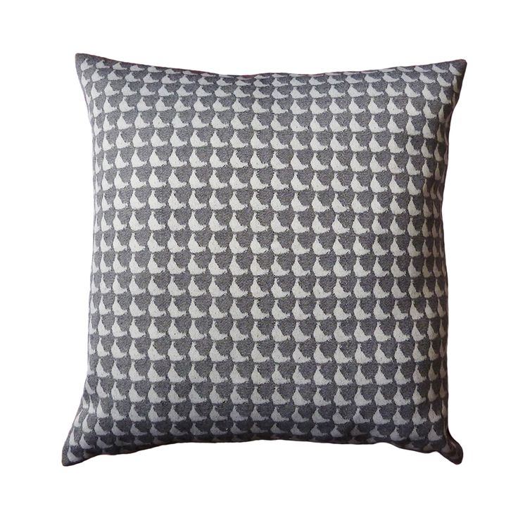 A staple print of the Jacquard Woven Neutral collection, this cushion interprets the Puffin eye print in contrasting grey tones. The reverse of the cushion is made from luxury velvet fabric in deep red.  440mm x 440mm  100% cotton twill front with luxe velvet reverse.  Concealed zip closure.  Duck feather cushion pad.  Signature dust bag included.  Made in the UK.