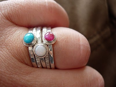 my 40th birthday present - birthston stacking rings by Murano Silver - ruby for me and the man - turquoise for the boy and opal for my girl